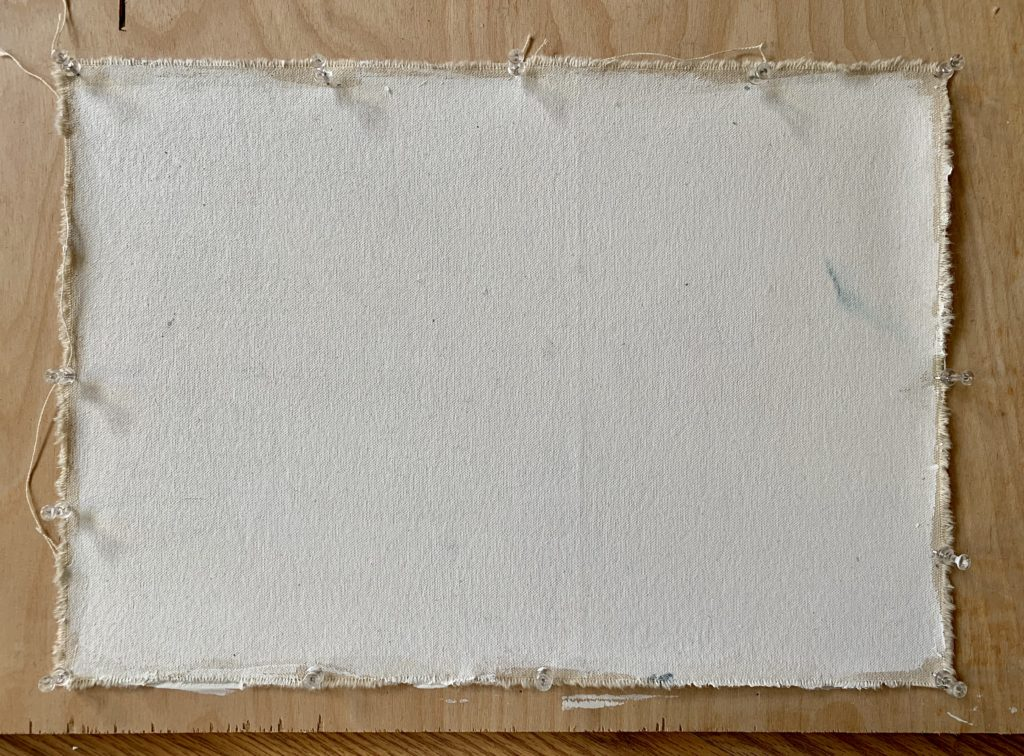 Gesso primed canvas pinned to a wood panel