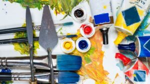 beginner oil painting supplies laying on top of each other on a canvas