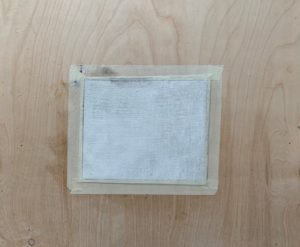 Gessoed canvas mounted with masking tape