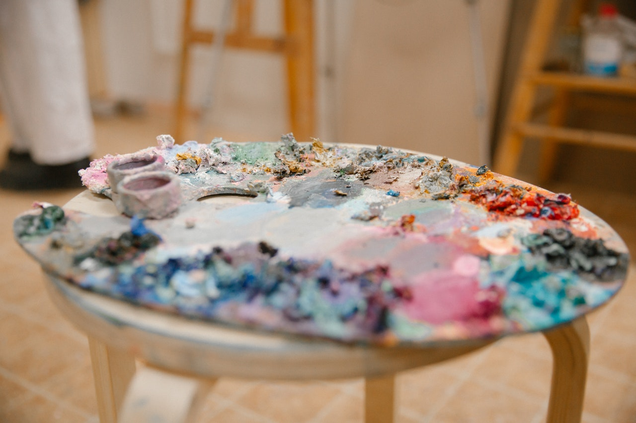 palette-of-paints-on-chair-in-workshop-3959113