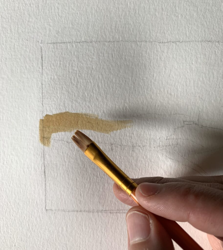 applying coffee watercolor paint to watercolor paper