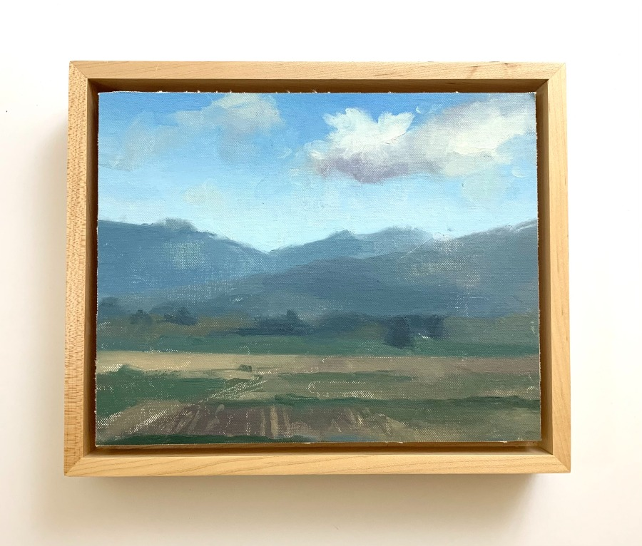 landscape painting mounted in a floating frame