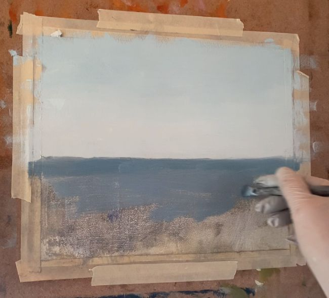 artist painting water in a seascape painting