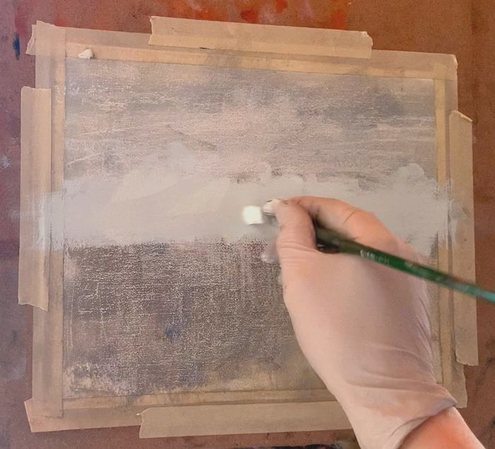 Starting to paint the sky in an ocean painting