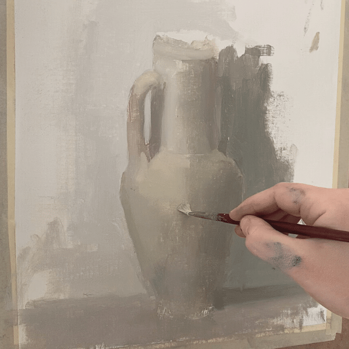 artist with brush painting still life