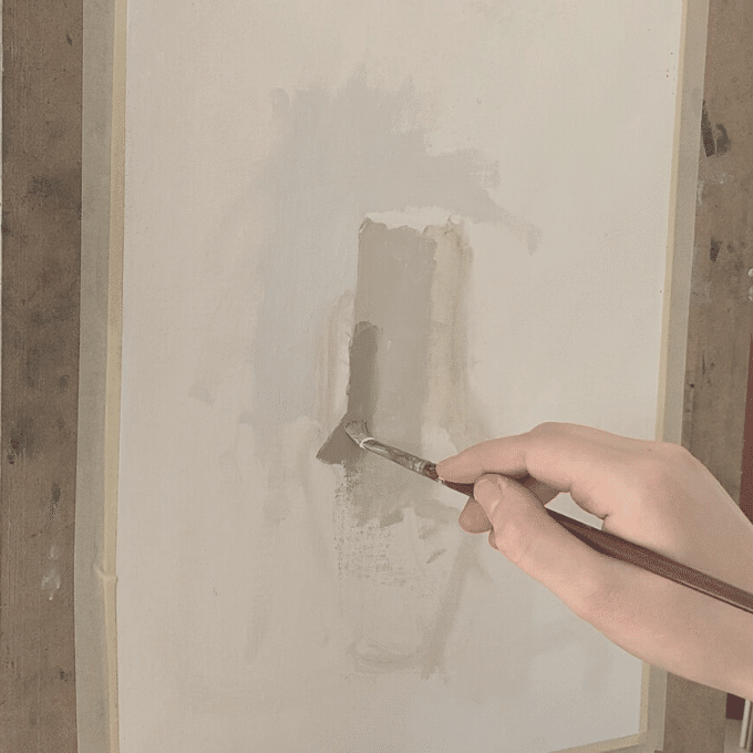hand with brush painting a shadow