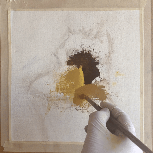 An artist's hand holding paint brush, showing how to paint sunflowers by adding medium yellow color value