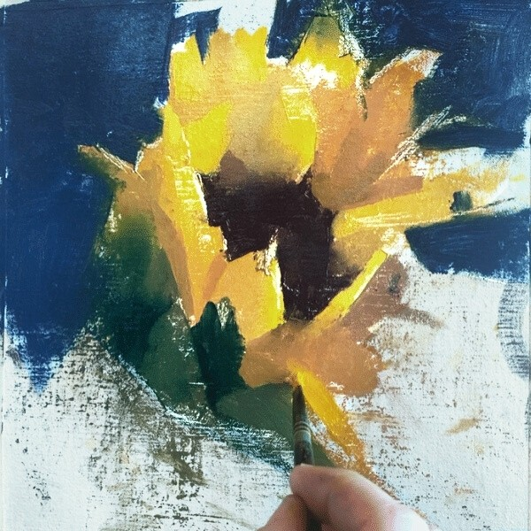Artist painting sunflower petal shade of yellow color