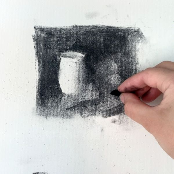 hand holding drawing charcoal thumbnail sketching