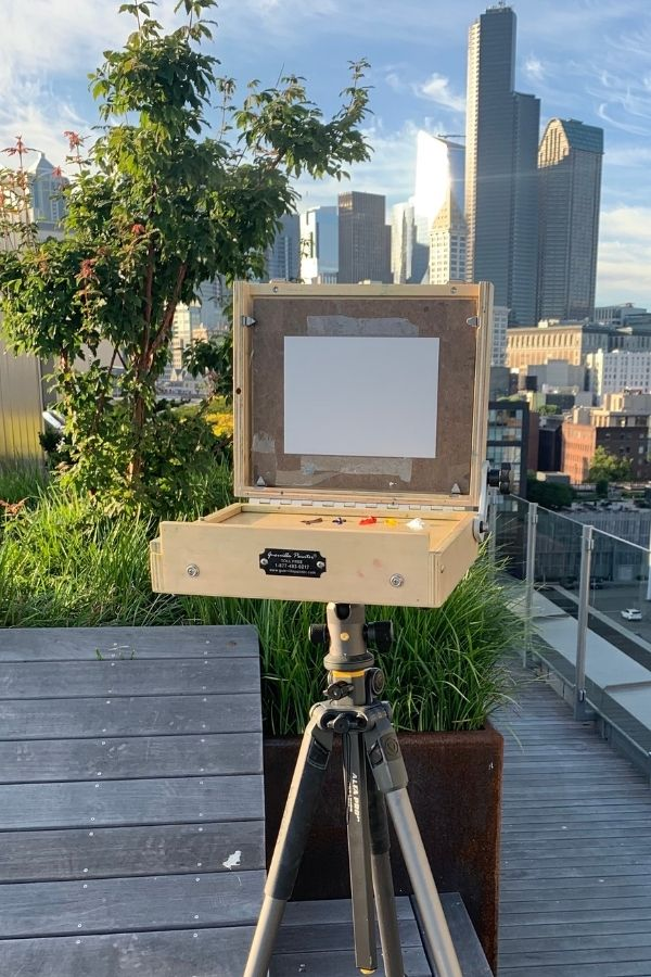 pochade box mounted on a tripod, showing how to travel art supplies